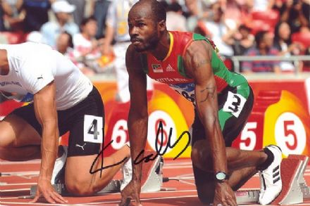 Kim Collins, Olympics sprinter, signed 6x4 inch photo.